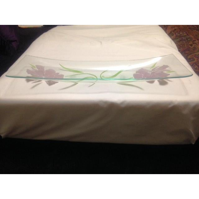 This is a Mid-Century clear acrylic tray with pink flowers. The piece has scratches on the tray as well as small chips on...