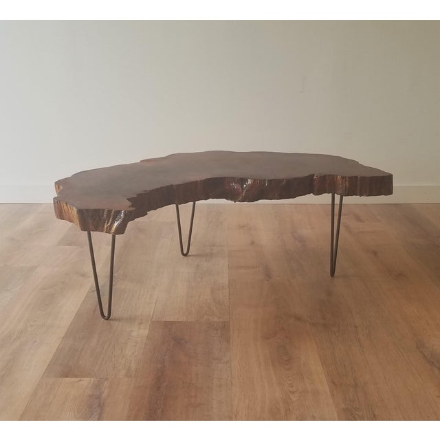Beautiful 1960s live edge table which could be used as a side table or compact coffee table. The organic edge complements...
