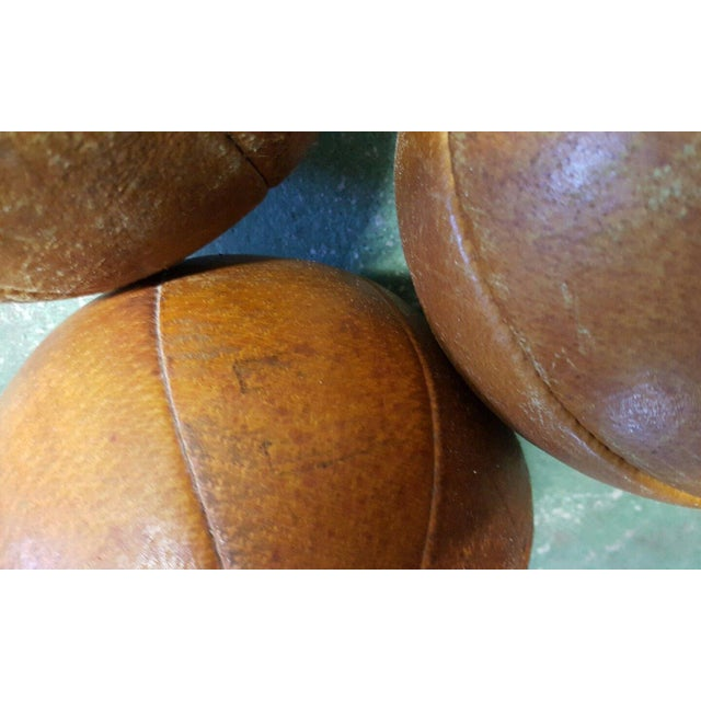 """This set of three medicine balls was made in Germany in the 1950s and is marked with """"Favorite"""". One ball weighs 1kg, the..."""