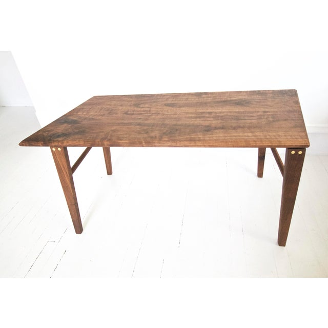 Light and airy mid-century modern and minimalist coffee table made with beautiful, highly figured Claro Walnut and solid...
