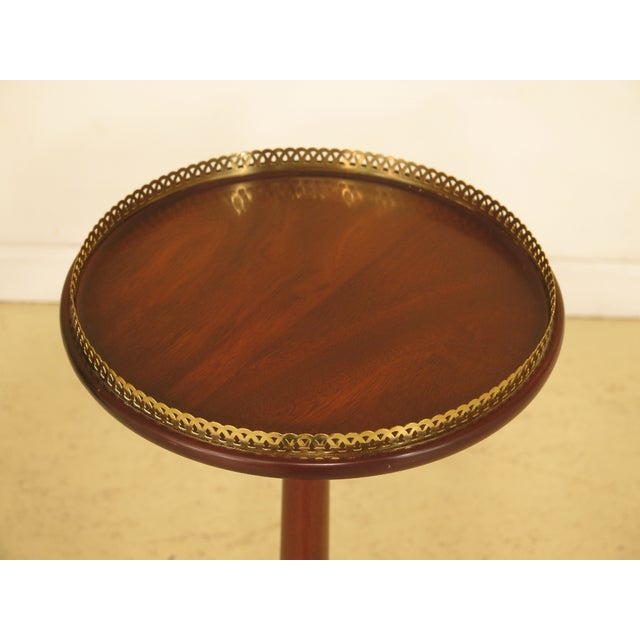 Henkel Harris tall mahogany pedestal table with Brass gallery. Made in 1988. Features high quality construction, Queen...