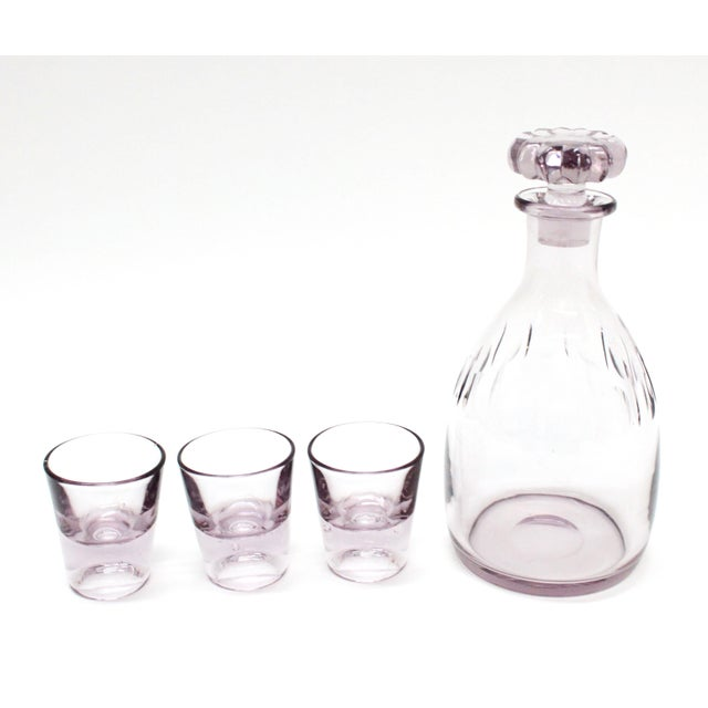 This is a beautiful light Amethyst Decanter with three matching glasses. Has the original stopper which is a very pretty...