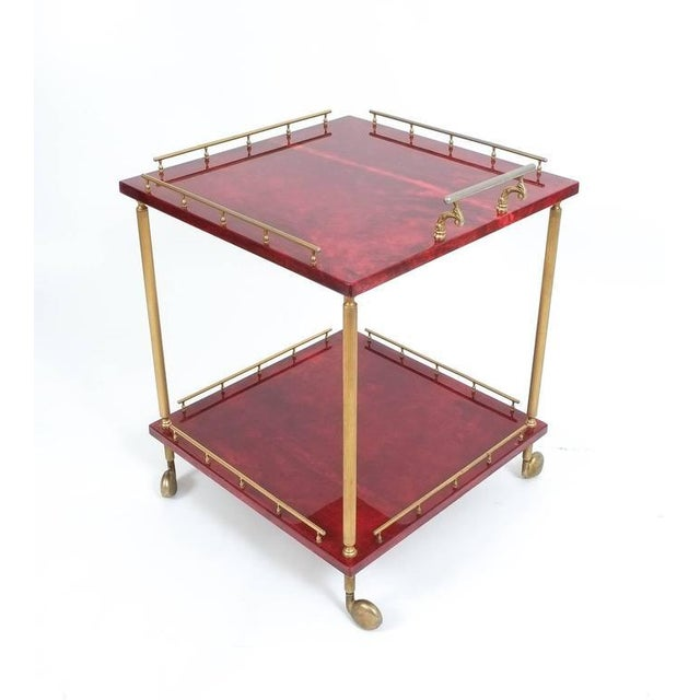 "Elegant 22"" x 22"" liquor or bar cart by Aldo Tura Milan, Italy. It's composed of two square dyed lacquered goatskin trays..."