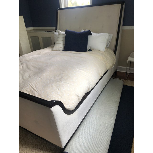 Very glam upholstered queen bed having off white plush upholstered headboard, footboard, and side rails, perfectly...