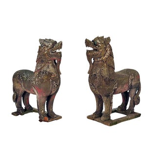 Weathered Asian Wood Palace Lions - A Pair For Sale
