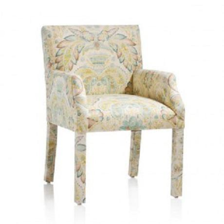 A dining chair with upholstered legs and a unique print fabric from O. Henry House. A one of a kind piece!