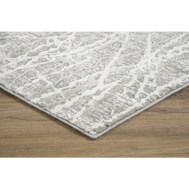 Jeeves Taupe displays a visually striking design of intersecting lines set against faded colors, providing a bold,...