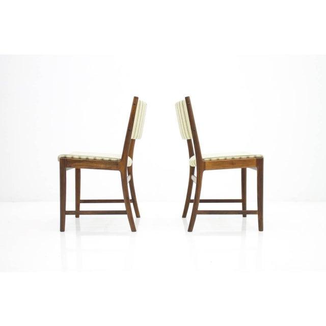 Nice pair of side chairs by Kai Lyngfeldt-Larsen for Søren Willadsen. Very good condition with original fabric.