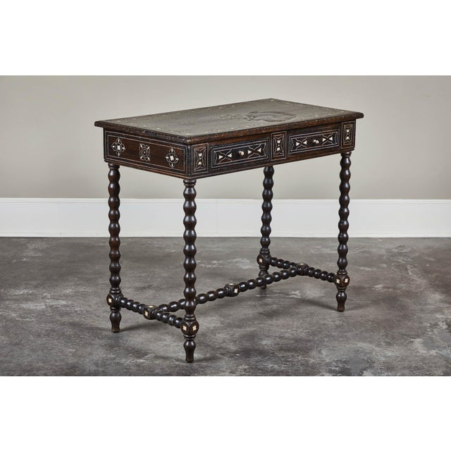 A late 19th century Spanish Colonial style console table with two drawers. With later metal and bone inlay. Walnut...