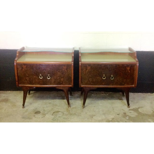 These side tables are stunning! They have a two tiered glass top and the bottom piece of glass is tinted or painted a...
