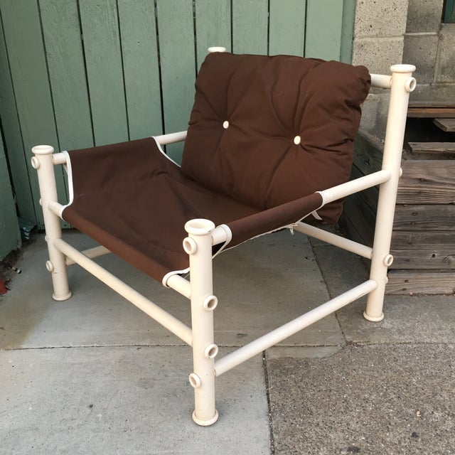 Nice mid-century lounge chair made of white pvc pipe. Is in excellent condition with brown canvas upholstery and white...