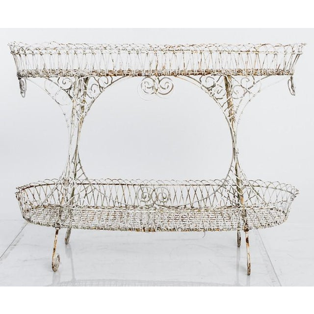 Antique English white wire-work planter circa 1850. Two tiers, with a lovely patina. Height of the lower tier is 12 inches.