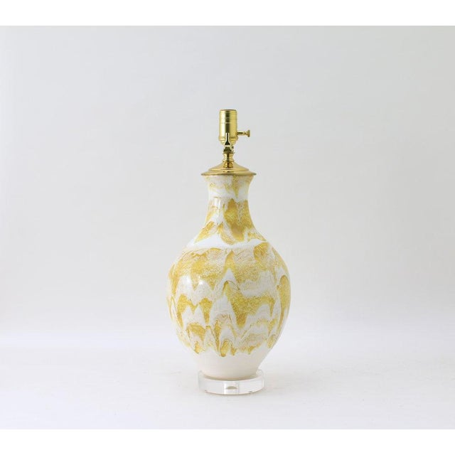 The ATHENS lamp is shown in our Mustard Drip glaze. Handmade and signed by Paul Schneider. Lead time three weeks. LAMP...