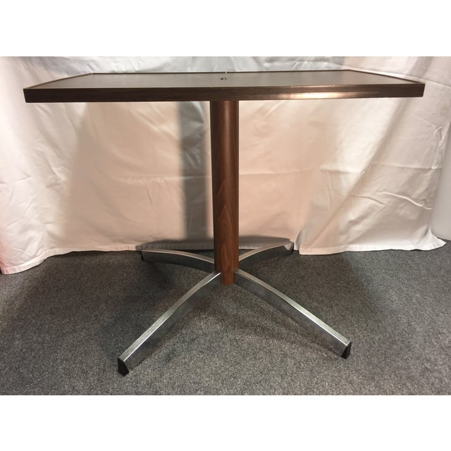 MCM Gusdorf wood grain and chrome tv stand. Table features a wood grain laminate top with chrome feet.