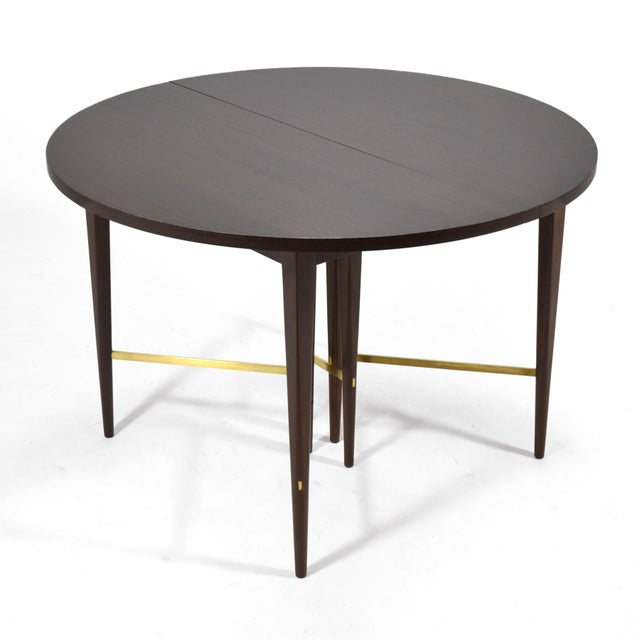 "This exceptional Paul McCobb dining table by Calvin has six 12 5/8"" leaves affording it incredible versatility. It can..."