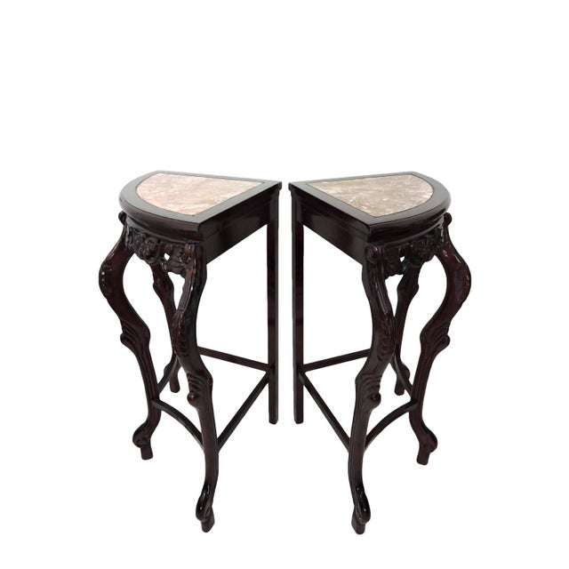 Versatile pair of ornate Italian style side tables, pedestals or demi lune topped with rosso/pink marble. Ornate carving...