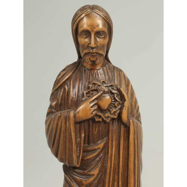 Beautifully carved from wood, is a sculpture of Jesus, signed R. Vergnes, dated 1949. Signed and dated.