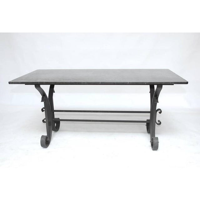 "Stunning Italian wrought iron and black marble dining table featuring a scrolled iron base constructed from 2"" wide flat..."