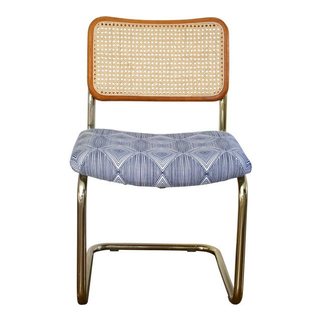 Brass Cantilever Cane and Blue Print Upholstered Chairs For Sale