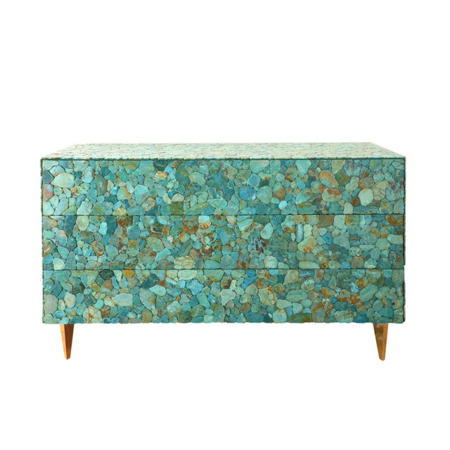KAM TIN Large turquoise chest of drawers Covered of polished real turquoise cabochons, wood, brass With three opening...