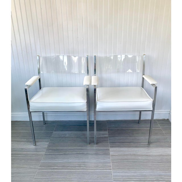Pair of Modern Lucite and polished aluminum arm chairs attributed to Milo Baughman for Design Institute America (DIA)
