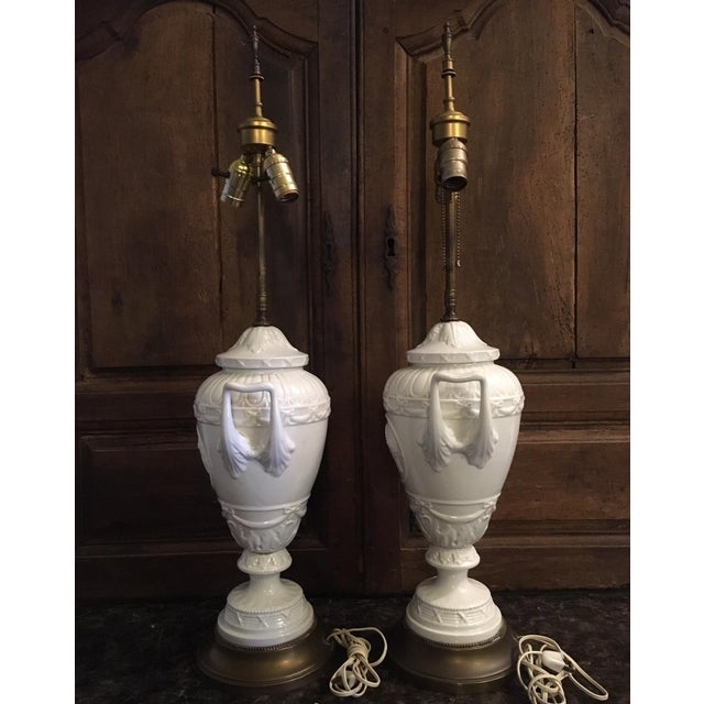 Pair of neoclassical Wedgwood French Empire style white glazed porcelain lamps with bisque cameo medallions in the Greco...