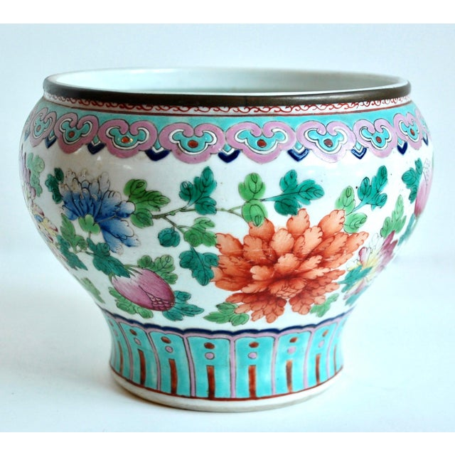 A gorgeous 19th century Famile Rose pot made for the Thai market with protective brass band on rim.