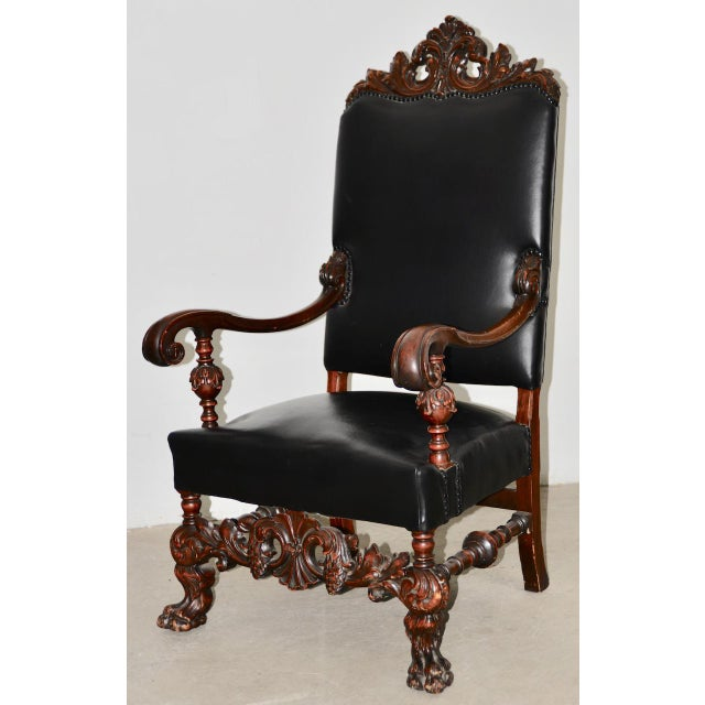 19th Century Jacobean Walnut Hand Carved Arm Chair w/ Leather Upholstery Finely carved walnut arm chair c.1890s. This...