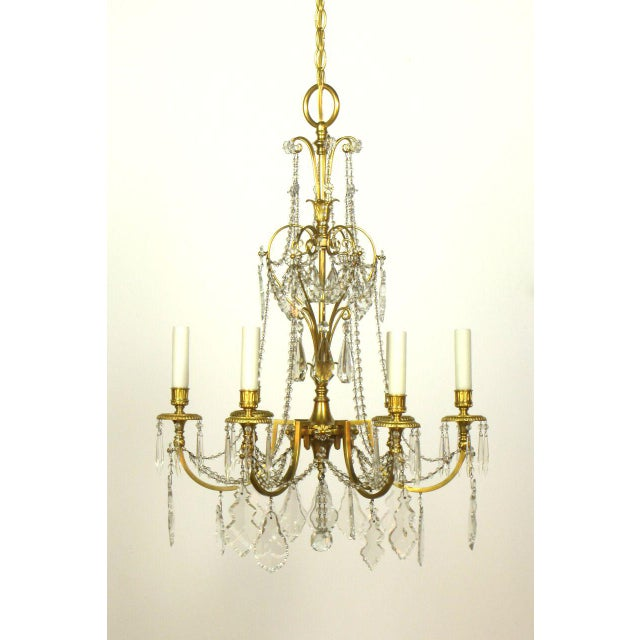 6 lights gilt bronze and crystal. Beaded crystal and fine casting. early electric. Turn of the Century. We also have a set...