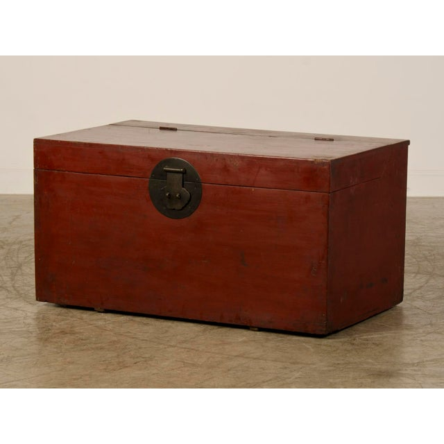A large antique Chinese red lacquer trunk from the Kuang Hsu period in China circa 1875 the the original metal hardware....