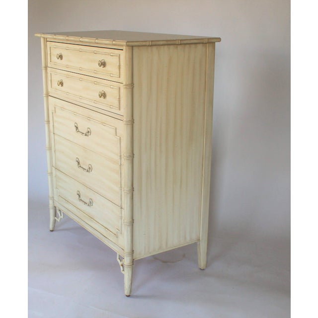 Faux bamboo highboy dresser by Thomasville with brass and cream colored drawer pulls. Some minor age wear to finish.