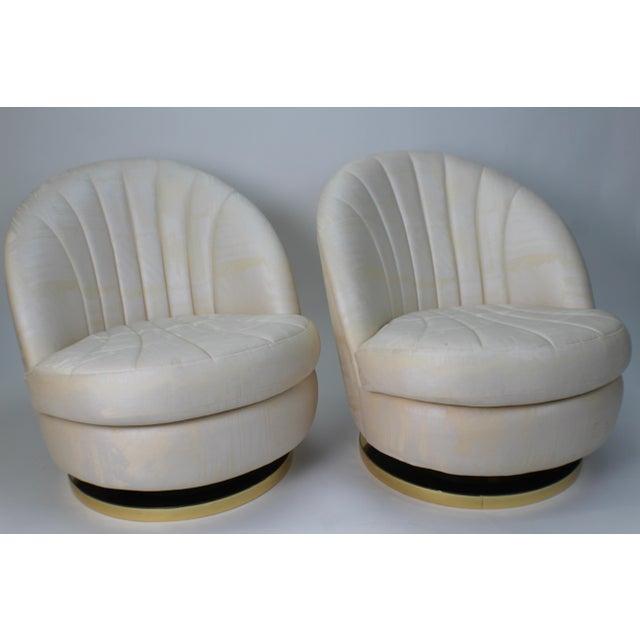 Milo Baughman for Thayer Coggin gold base swivel chairs. Two matching gold base swivel chairs, small burn from something...