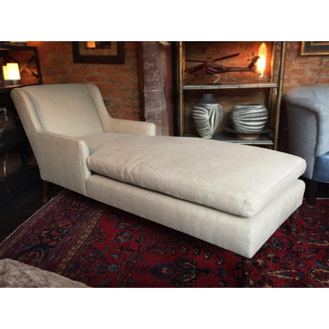 This Danish chaise lounge is reupholstered in soft Belgian linen. The masterful tailoring is apparent in the elegant...