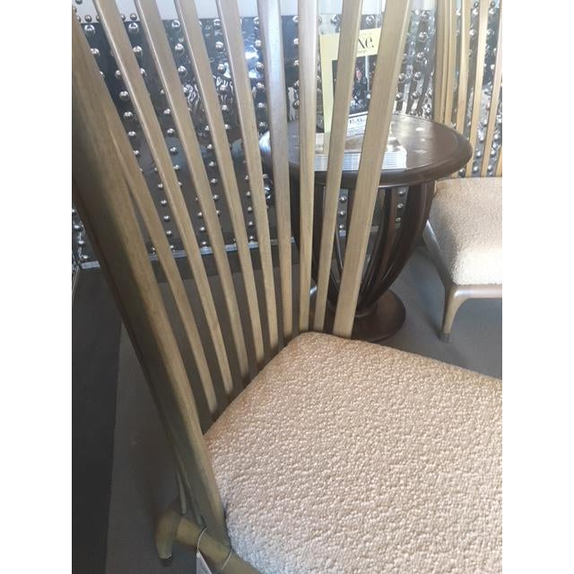 Beautifully designed and crafted, conversation piece chair. Seat upholstered in cream boiled wool fabric. Low to ground...