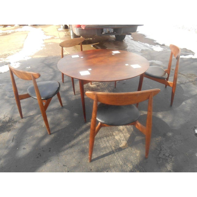 "This dining set / game table includes a 45"" diameter solid and veneer teak or walnut table that stands 25 1/2"" tall and is..."