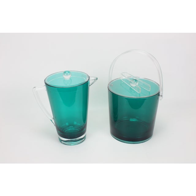"""Matching 1980s vintage green & clear Lucite pitcher and ice bucket. Marked, """"Made in Taiwan."""" Pitcher measures: 9"""" x 6"""" x..."""