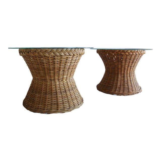 A pair of absolutely fabulous handwoven mid century rattan tulip tables manufactured by The Wicker Works in San Francisco-...