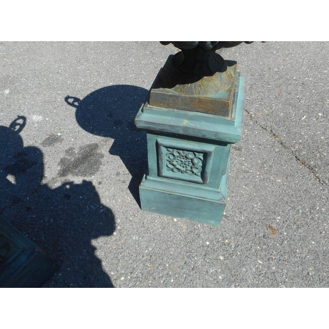 Pair of Cast Iron Urns on Pedestal Bases | Chairish
