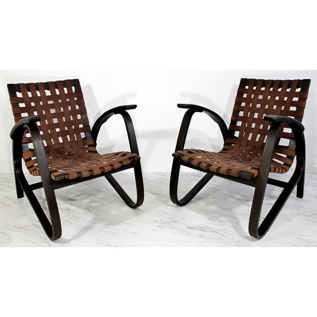 For your consideration is a gorgeous pair of black bentwood arm chairs, with brown woven original strap seats, by Jan...