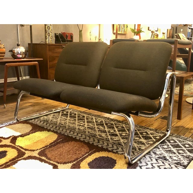 Vintage Steelcase loveseat with brilliant tubular chromed steel frame and original brownish-green tweed upholstery. A few...