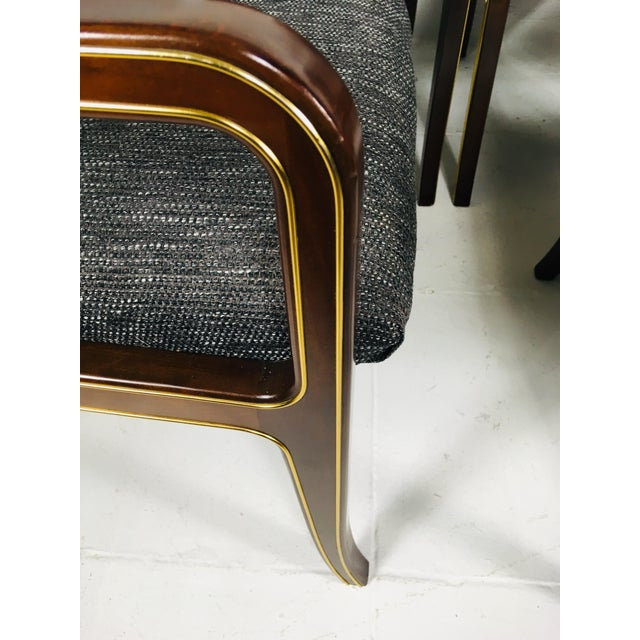 This is a set of six dining room chairs by Baker. These dining room chairs feature for side chairs and two arm chairs....