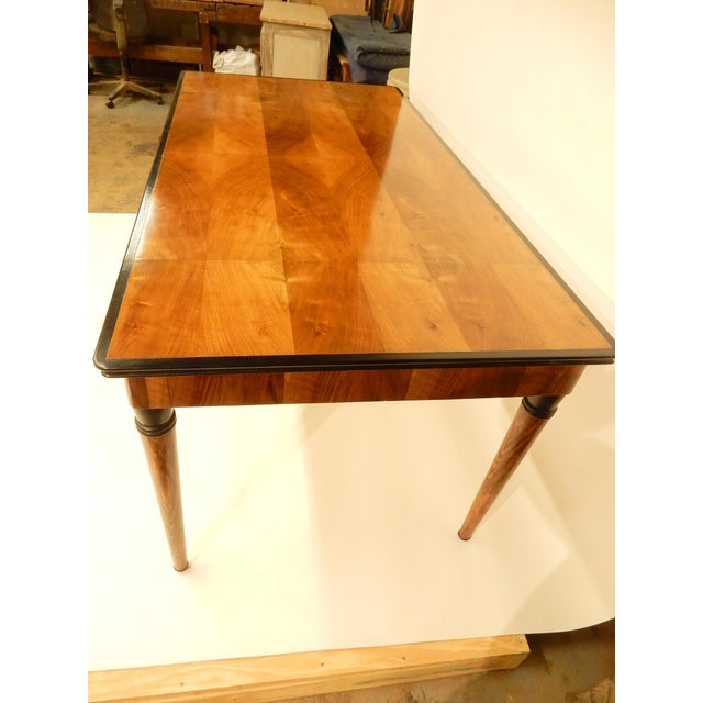 Carefully restored 1940's French walnut veneer dining table.