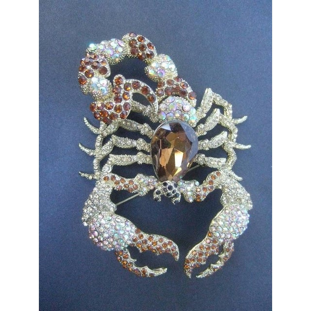 Massive glittering crystal scorpion brooch The large scale scorpion is encrusted with brilliant crystals in smoky brown...
