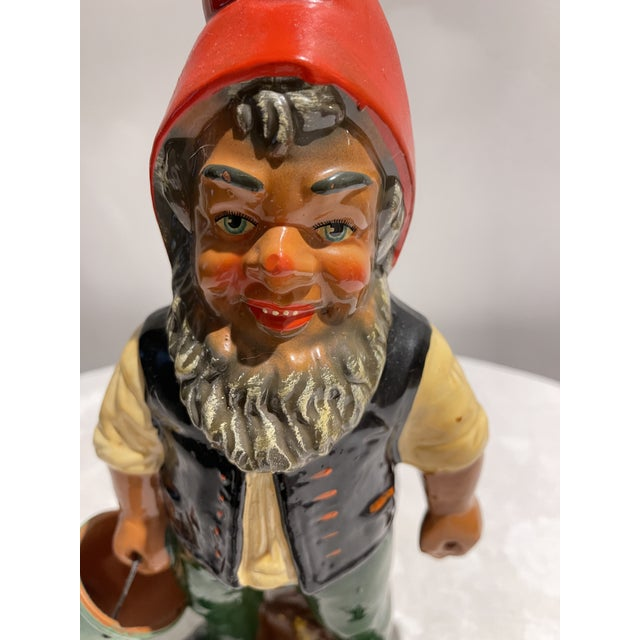 Charming hand-painted gnome made in the 1950s. Gnome is carrying a bucket and has a grin on his face. Made by Heissner and...