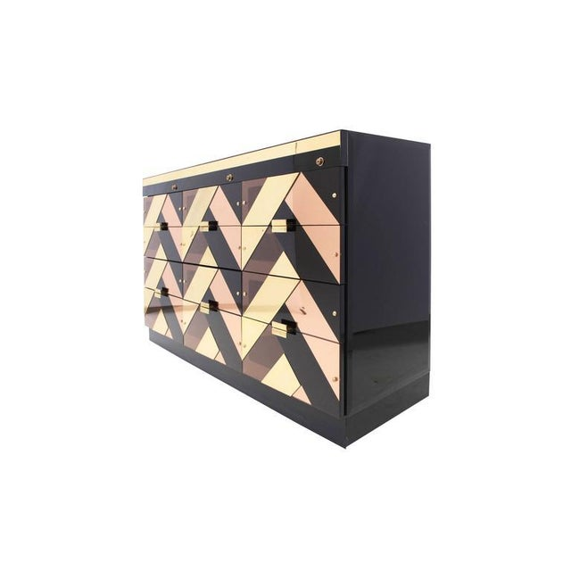 Custom high-end repurposed Hollywood Regency style Three door credenza with twelve drawers. Black hyalith glass sides and...