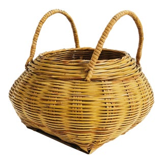 Vintage Medium Woven Basket With Handles For Sale