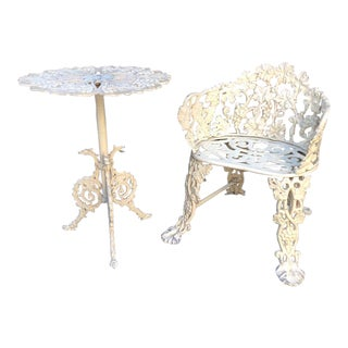 Vintage Paint Decorated Outdoor Cast Iron Table and Chair For Sale