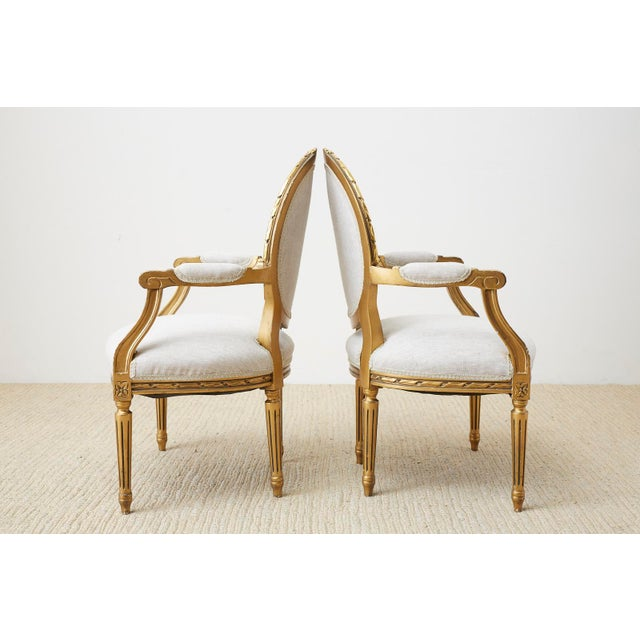 Early 20th Century Pair of Louis XVI Style Giltwood Linen Fauteuil Armchairs For Sale - Image 5 of 13
