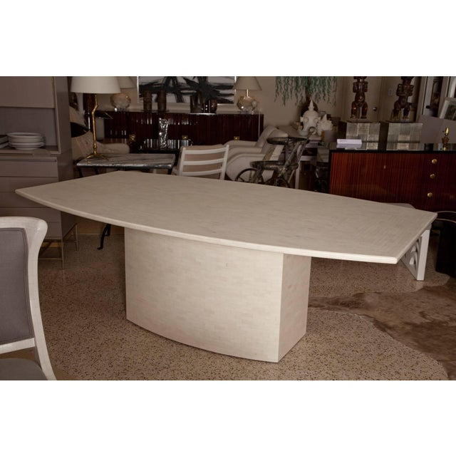 Professionally restored and refinished dining table in tessellated bone by Enrique Garces, Colombia, circa 1980. Rich...