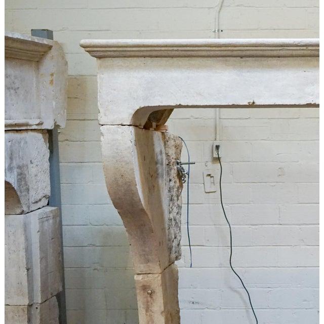 "Antique Louis XIII limestone mantel. Origin: France, circa 1680. Measurements: 70.75"" H x 78.75"" W x 51'' D Firebox:..."